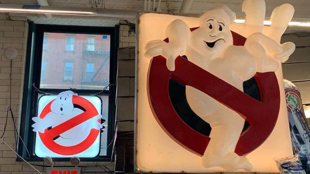 Hook & Ladder 8 firehouse displays screen used Ghostbusters II sign alongside new replica