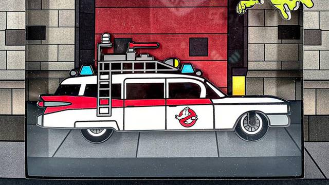 Limited edition Ghostbusters Ecto-1 pin features working wheels and glows in the dark