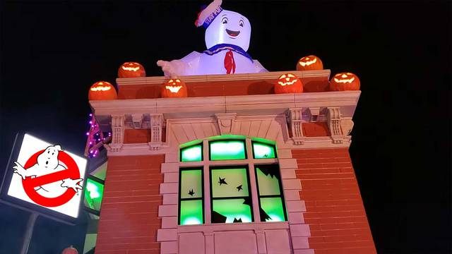 Parents build a Ghostbusters firehouse playhouse for their kid, makes for an amazing Halloween decoration